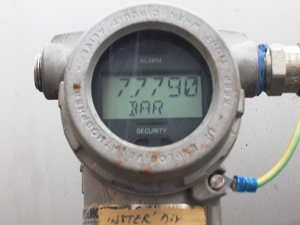 Industrial pressure transmitter indicating 7.7 bar